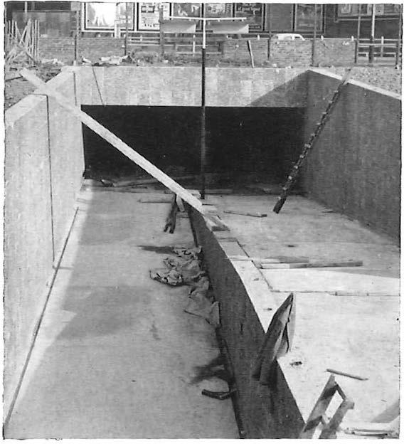 Fig. 3 (above) : Subway being constructed Fig. 4 {below) : 9way duct, with cables still working, surrounded by concrete used as a sublevel car park and shopping centre.