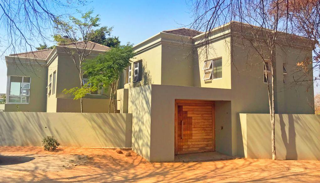 kitchen and lounge/dining area Three garages plus potential for one carport Covered patio with large entertainment area with a pool and koi pond Large staff accommodation Themba 083 608 7059