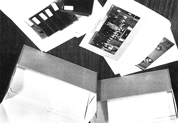 Photographic materials are usually stored by type, with slides, negatives and prints kept together.