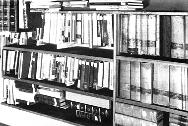 Store books in your reference area unless they especially valuable or fragile. Keep a record of all books in your archives, ideally in your card catalogue.