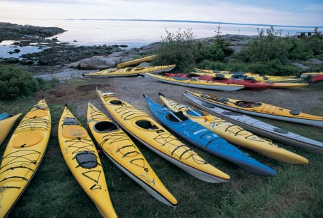 NELSON BOISVERT/PARKS CANADA Ecotourism such as sea-kayaking is often assumed to be a source of
