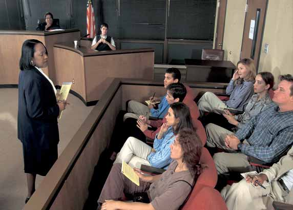 HOW THE U.S. IS GOVERNED Texas: In a scene played out in many courtrooms, an attorney addresses jurors in a civil trial.