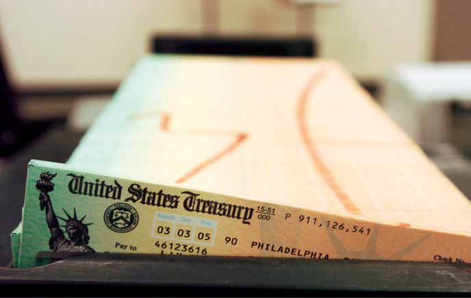 Old-age pensions, known as Social Security in the United States, are paid to millions by the U.S. government. Above, printed checks wait to be mailed from the U.S. Treasury s fi nancial management facility in Philadelphia, Pennsylvania.