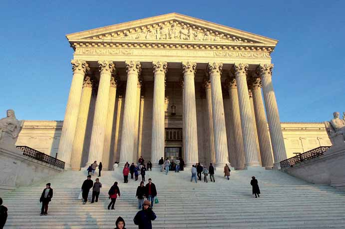The U.S. Supreme Court building in Washington, D.C., houses the nation s highest court. The nine justices on the court play a decisive role interpreting legal and constitutional issues for the nation.