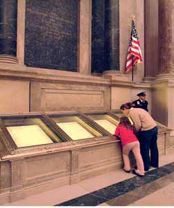 Overview of national, state, and local governments in the United States Visitors closely inspect the original pages of the U.S. Constitution of 1787 in the rotunda of the National Archives building in Washington, D.