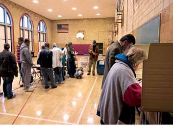 Similarities and differences between the U.S. system of government and other forms of democratic government Arab-Americans vote in the 2004 U.S. presidential election in a school in Dearborn, Michigan.