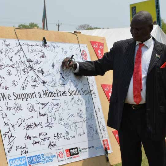 Deputy Chairperson of the National Mine Action Authority Major Gen Nyang Chol Dhuor adds his signature to support a mine-free