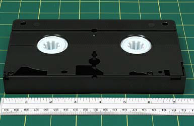 A VHS (or S- VHS) logo is usually imprinted on the cassette in the upper right-hand corner, while manufacturer name is imprinted in the upper left.