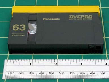 "DVCPro FORMAT NAME DVCPro (aka D7) ANALOG OR DIGITAL Digital DATE INTRODUCED 1995 DATES IN USE 1995 to present TAPE WIDTH 1/4 TOP BOTTOM CASSETTE DIMENSIONS Large cassettes measure 4 7/8"" x 3"" x"