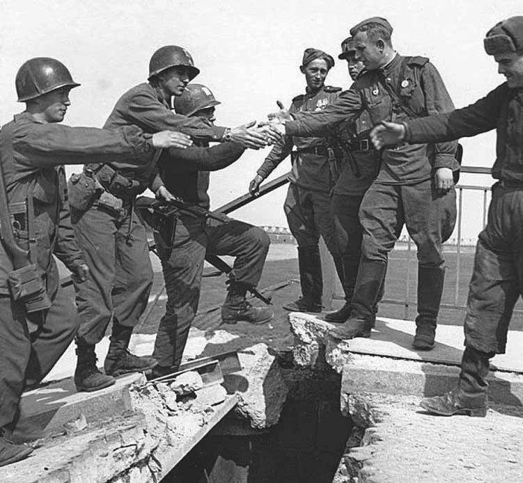 April 25, 1945: Russians and Americans link at Elbe Russian and American troops have joined hands at the River Elbe in Germany, bringing the end of the war a step closer.