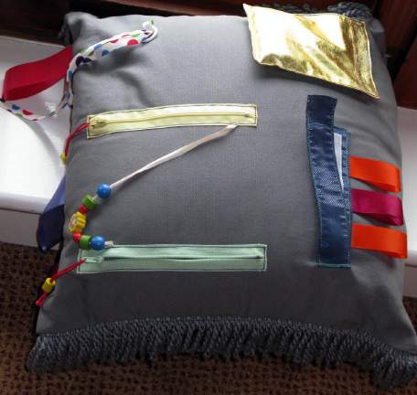 Sensory cushions and blankets, sensory books made from various textile material, with zips, ribbons, buttons, pockets Can be purchased or self-made although they are like toys they should be