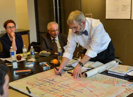 Above (Left): Dennis Carlberg, Director of Sustainability at Boston University draws out an idea at the Back Bay charrette session.
