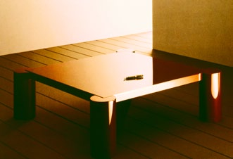 The coffee table above is a lacquered version following the same structural system as the tables on the previous page.