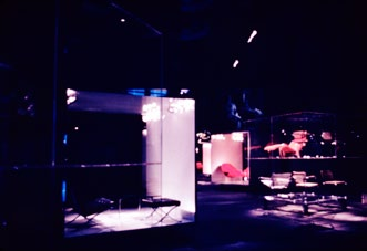 In the large hall, to mediate its enormous height, we sometimes placed a second cube displaying rear-projected images on