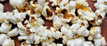 Once the popcorn begins to pop, turn the heat down to medium-low and