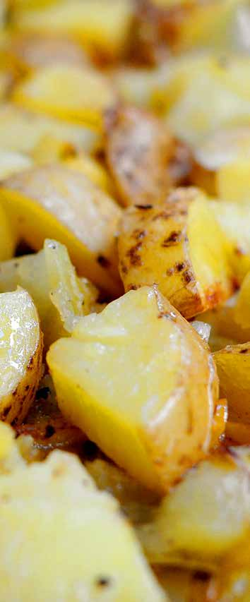 4 medium potatoes, chopped into bite-sized pieces 4 medium chilies, chopped into bite-sized pieces 2 cloves garlic, unpeeled 1 tbsp butter, melted In a large roasting pan, tumble together the