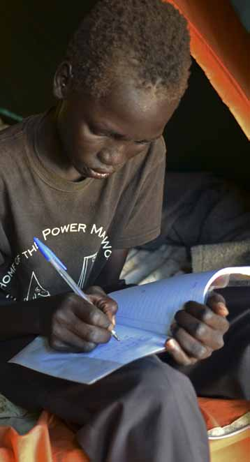 3 3. Barriers to education progress and learning 7 A young boy writes in his maths book in the Tomping Protection of Civilians site for people
