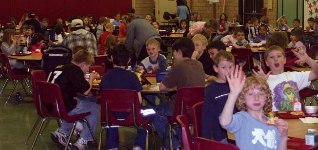Photo: Tom Hylton Children enjoy lunch in the First District Elementary School, one of three historic neighborhood schools in Meadville. Each of the K-6 schools enrolls 300 or fewer pupils.