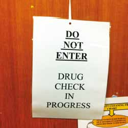 A conspicuous sign was prepared for posting on the treatment room door stating Do not enter, drug check in progress.
