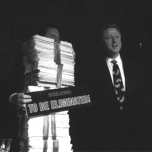 President Clinton and Vice President Gore display federal regulations that were eliminated as part of