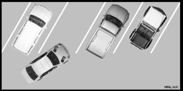 Move forward slowly, turning the steering wheel left or right as appropriate, until the vehicle reaches the middle of the space. Center the vehicle in the space and straighten wheels.
