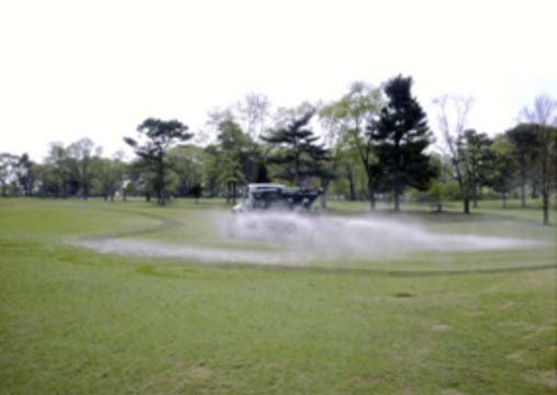 Figure 3-6. FGD gypsum being applied to the soil surface of a golf course. (Sumner and Larrimore, 2006.) Other Uses of Gypsum in Agriculture A report by Dick et al.