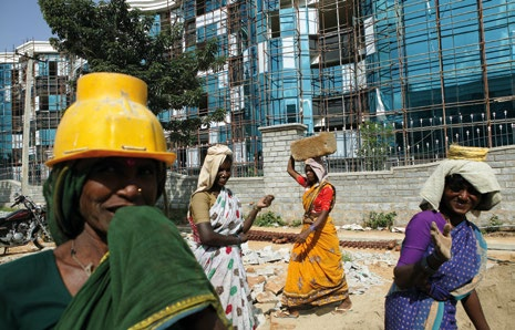 EXTREME INEQUALITY ECONOMIC INEQUALITY COMPOUNDS GENDER INEQUALITY Female construction workers work to build offices for IT companies in a new technology park, Bangalore, India (2004).