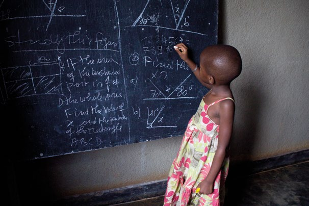 WHAT CAN BE DONE 2.3 Hamida Cyimana, 6 years old, does sums on a blackboard, Kigali, Rwanda (2012).