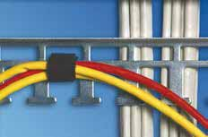 Copper cable excess can be stored separately from fiber glass excess within the Knürr rack systems: the copper cables