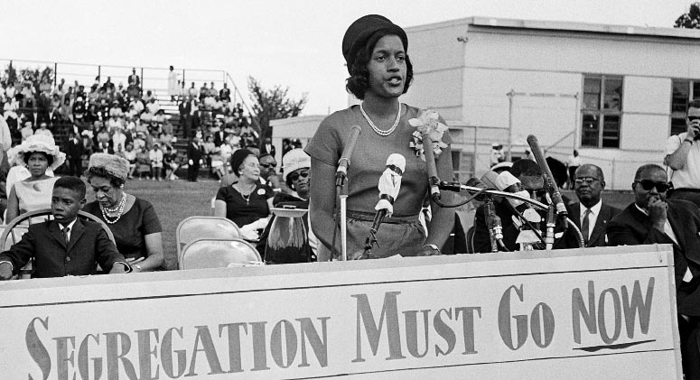 Myrlie Evers addresses a Howard University rally after the murder of her husband, Medgar Evers.