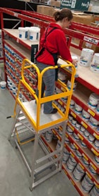 Figure 18: To access stock a worker uses a step platform with barriers on all sides. 6.