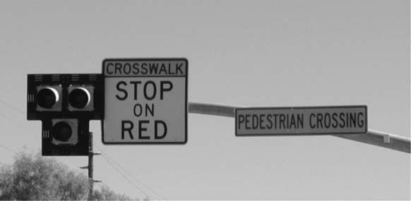 The HAWK beacon signal, used exclusively in Tucson and Pima County, Arizona, dwells in a dark mode until activated by a pedestrian by means of a pushbutton.