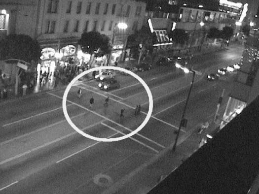 39 Figure 16. Video record of pedestrians crossing in twilight. did not always provide the detail and resolution necessary to record certain characteristics.