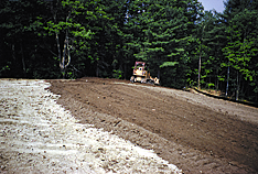 tracked (compacted) with a bulldozer, not smoothed.