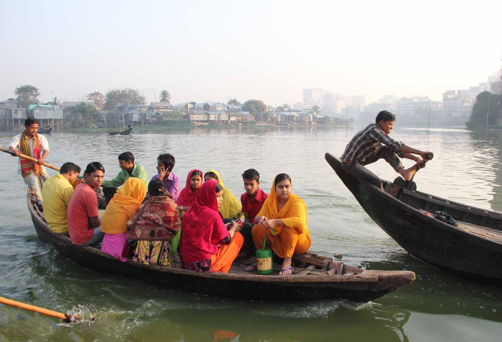 BISHAWJIT DAS Garment workers living on an island slum in central Dhaka begin their morning commute by ferry.