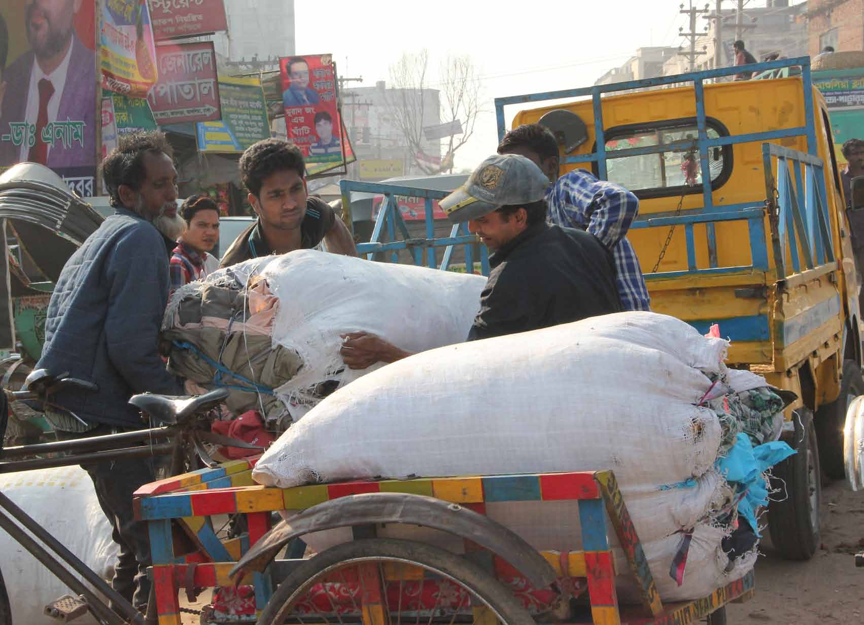 BISHAWJIT DAS Materials and finished goods move between subcontracting factories on rickshaws and small trucks.