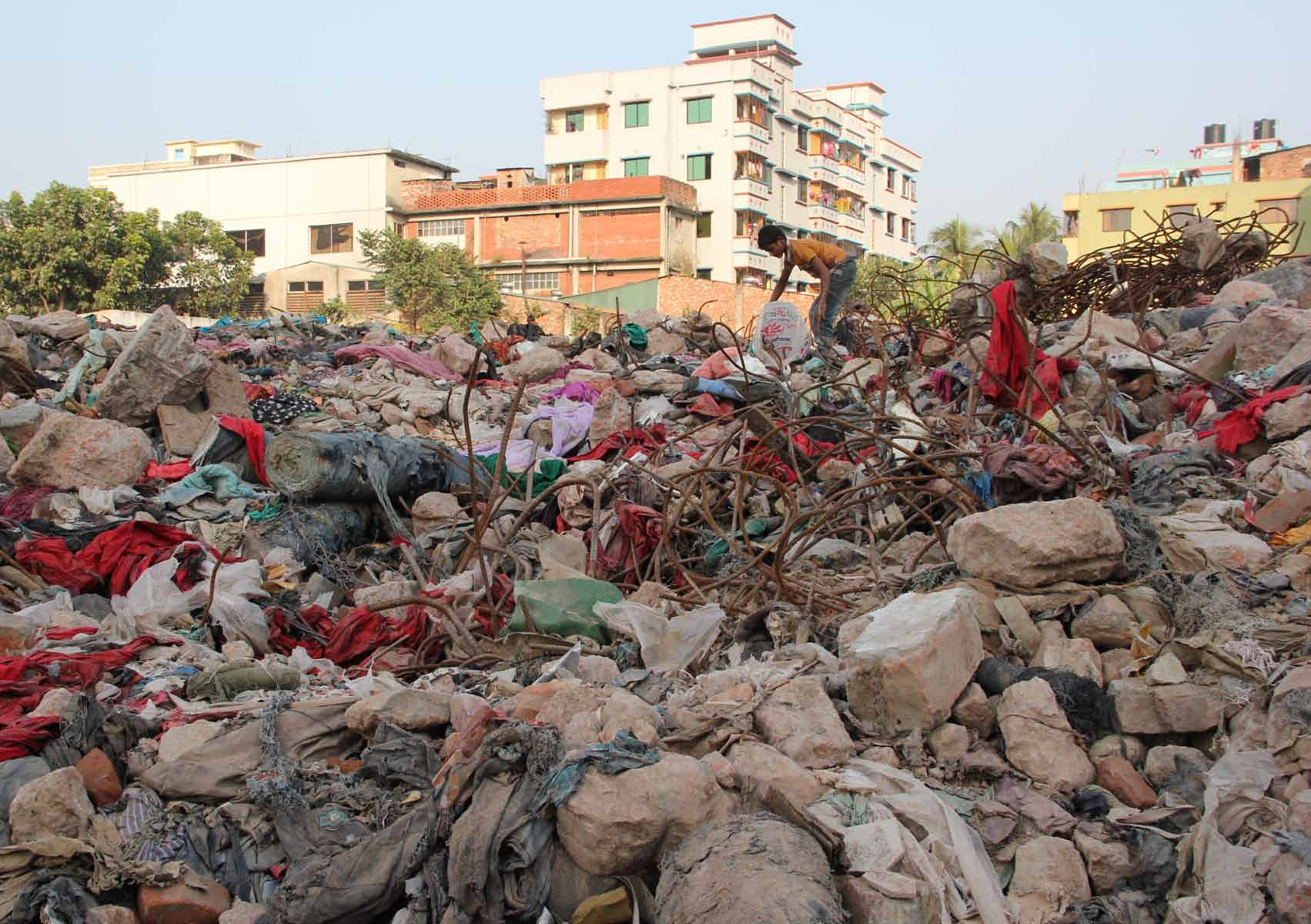 BISHAWJIT DAS Ten months after the collapse at Rana Plaza, bolts of fabric, pieces of finished garments, documents, building materials, and rebar from the factories that were located in the complex