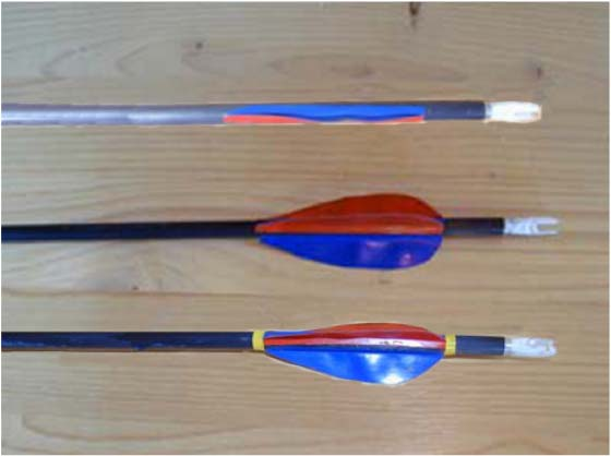 13 Do this two more times to complete the fletching of the arrow. Note: As the example shows in illustration 10.