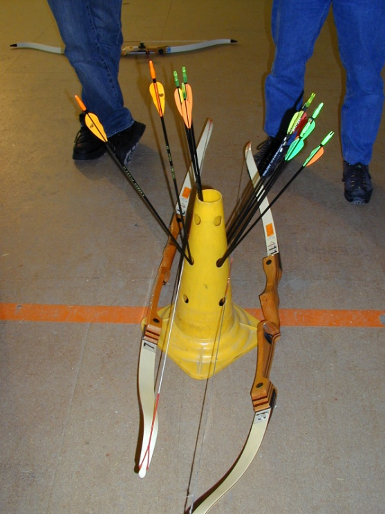 15. How to make your own ground quiver: Material needed: - an old street cone, - a drill, - a large drill bit.