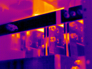 The digital photo (Figure 7) shows that the thermographer has placed a piece of electrical tape around one area of the bus bar.