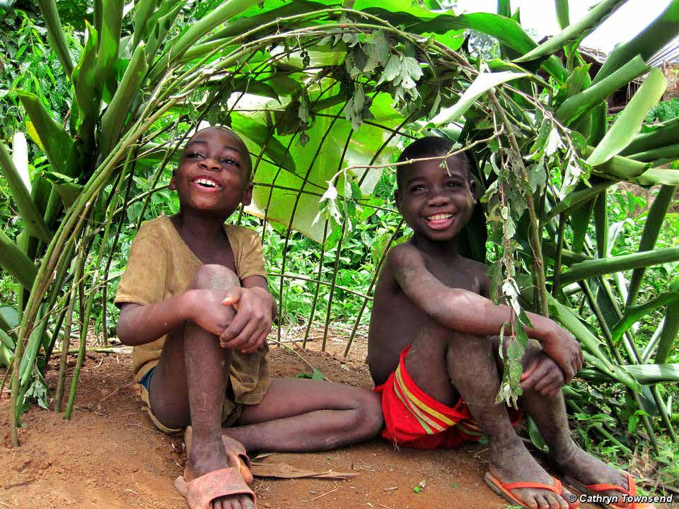 Image: Baka children playing in their forest. Across Central Africa, forest peoples are made to live in unhealthy roadside settlements.