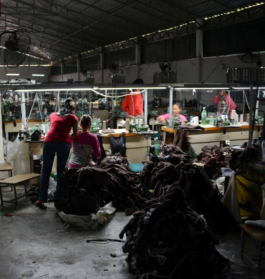 Workers in a small, unmarked subcontractor factory in Cambodia produce for a larger factory that