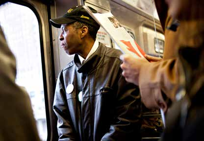 Tyree Johnson, who s worked for 20 years at a fast-food restaurant, rides a train on his way to work in Chicago.