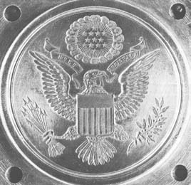 But the differences in style are marked: The border is without acanthus leaves; the whole design has been crowded upward; the eagle is more vigorous and uncrested; two arcs, instead of a straight