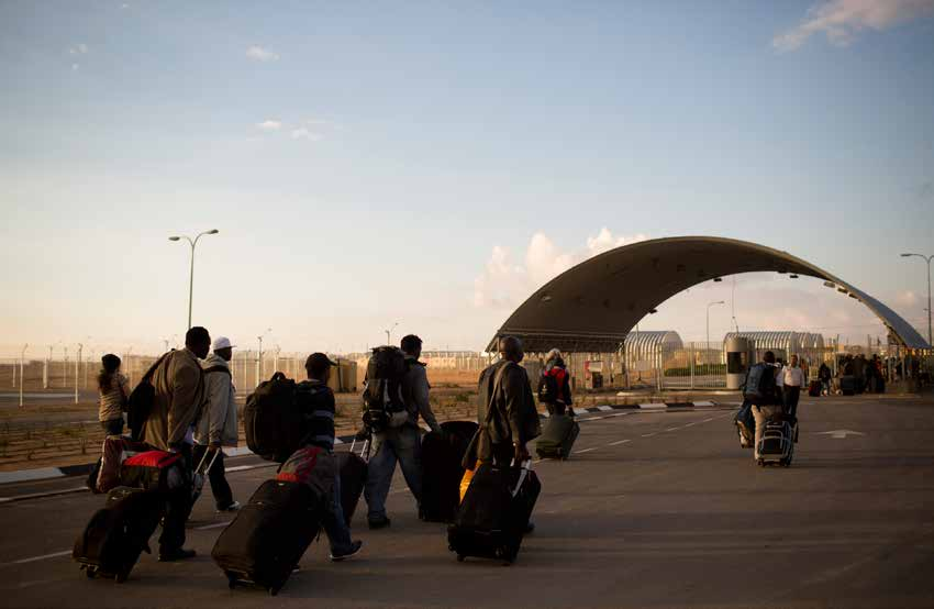 Eritreans and Sudanese report to the Holot Residency Center in Israel s Negev desert on February 17, 2014.