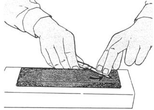 USING A SHARPENING STONE - Continued 4 After several strokes, reverse the blade and stroke the other side in a