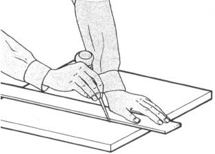 USING A SCRATCH AWL 1 Place material to be scribed on a flat surface. Place a ruler or straight edge on guide marks.
