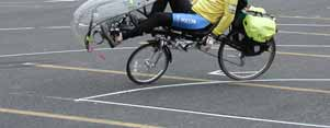 (16) The pedals on recumbent bicycles are usually well forward of the seat (figure 5). Two-wheeled recumbents can be difficult to learn to balance, especially those with under-seat steering.
