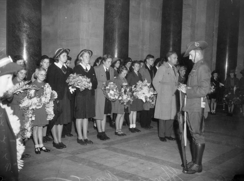 Schoolchildren in the Shrine of Remembrance observe two minutes silence before laying their wreaths on the Stone of Remembrance, Melbourne, 1944. AWM 140864 8.