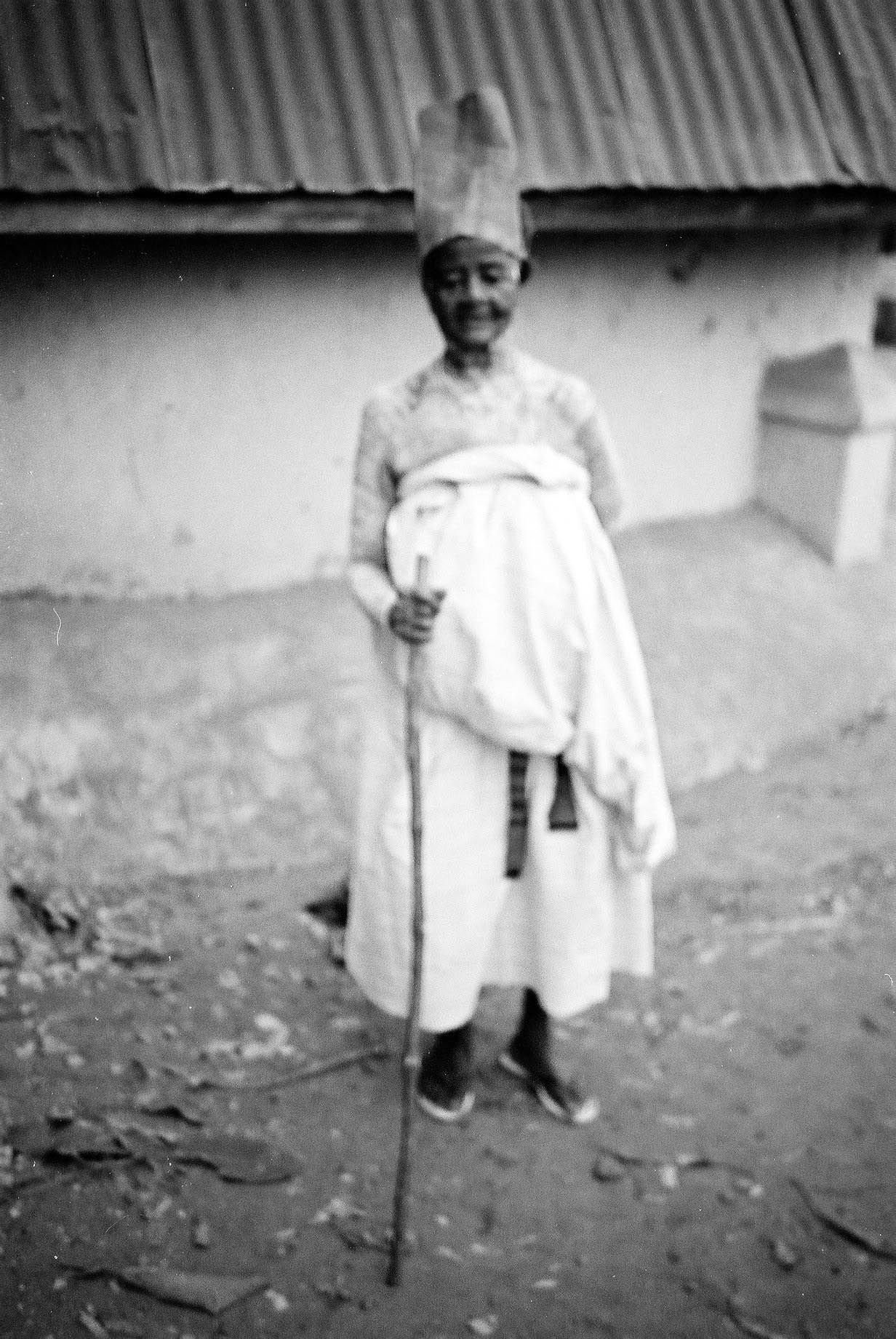166 PHOTOGRAPH 5. An elderly woman on her way to a shrine. She has decorated her body with white clay as a sign of a successful ending of a ritual festival.